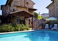 Country House Carfagna - Camere e ristorante in agriturismo, con piscina Assisi (Emilia Romagna)